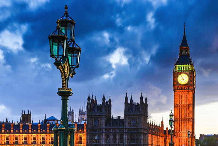 Photo from the London Bridge taken of the Houses of Parliament in twilight